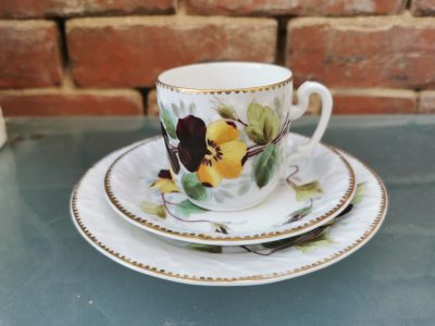 Antique hand painted pansy trio with gilded rim 1880s 1890s from Antik Seramika