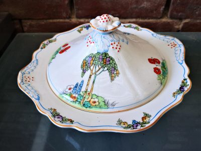 lid and rim of Art Deco Crownford pottery tureen hand painted with tall trees and flowers from Antik Seramika Essex UK