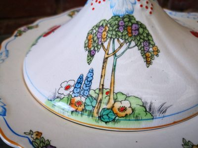close up of decoration on Art Deco Crownford pottery tureen hand painted with tall trees and flowers from Antik Seramika Essex UK