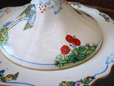close up of poppies on lid on Art Deco Crownford pottery tureen hand painted with tall trees and flowers from Antik Seramika Essex UK