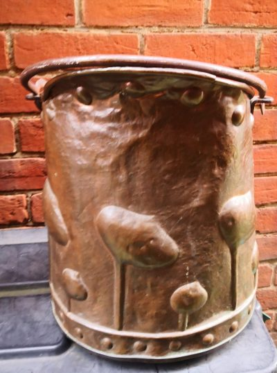 Side view of art nouveau antique arts and crafts copper coal bucket with hammered detail from Antik Seramika Essex UK