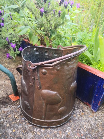 in the garden view of Antique art nouveau arts and crafts copper coal bucket from Antik Seramika Essex UK