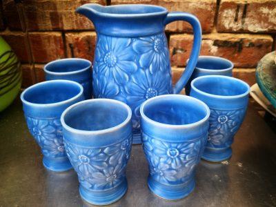 Art Deco possibly Beswick or Wade Heath lemonade set in bright blue with embossed daisies from Antik Seramika Essex UK