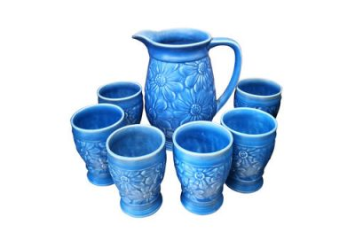 Cornflower blue embossed Daisy jug and six tall cups probably Beswick or wade heath